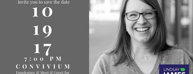Black and white photo of woman with shoulder length hair and glasses, smiling