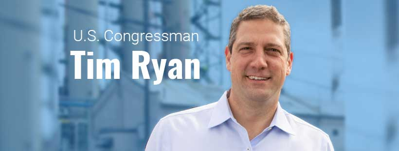 Tim Ryan before industrial structures