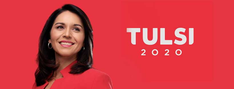 Tulsi Gabbard in red before a red background and white Tulsi 2020 logo