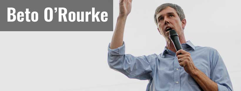 Beto O'Rourke in light blue shirt before a gray background