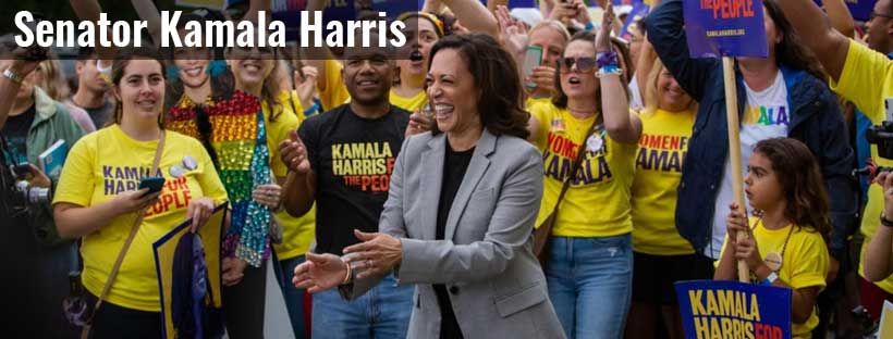 Senator Harris surrounded by a crowd of supports with campaign shirts and signs