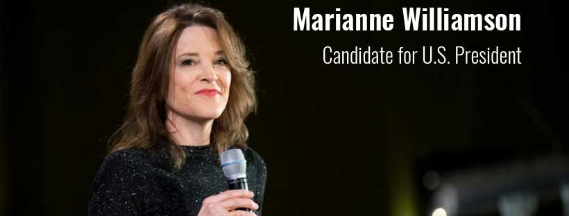 Marianne Williamson wearing black before a dark background
